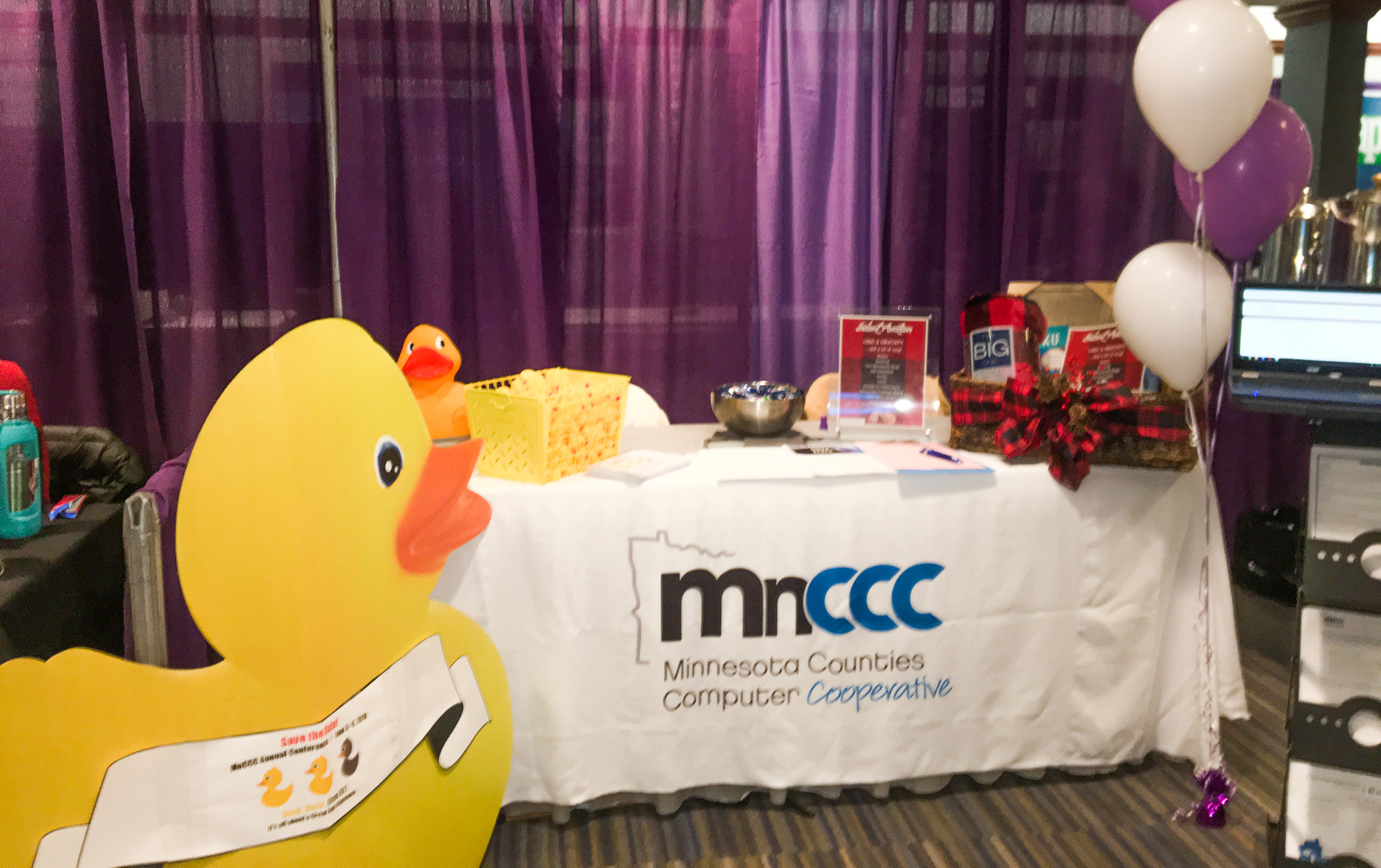 Photo of MnCCC booth with the big duck